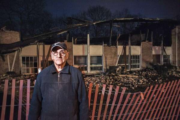 Leonard Apicella in front of the burned-out remains