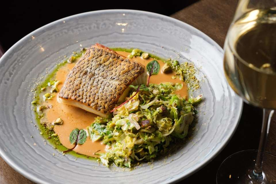 Pan seared Chilean sea bass with shaved Brussels
