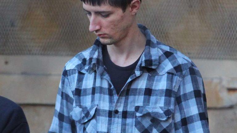 Boy Scout leader Edward Orenchuk III, 23, leaves
