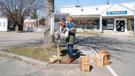 Founder Penelope Rudder stocks the Little Free Food
