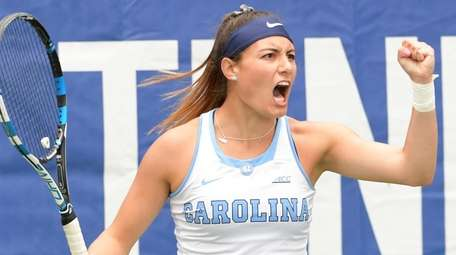 North Carolina's Alexa Graham reacts to their point
