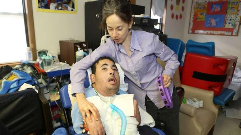 Special education teacher Molly Conway, 33, helps Justin