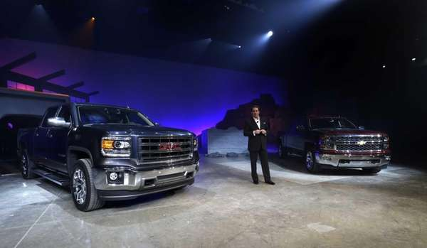 Mark Reuss, GM's North America president, stands along