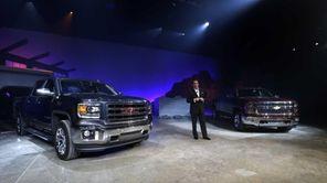 Mark Reuss, GM's North America president, stands along