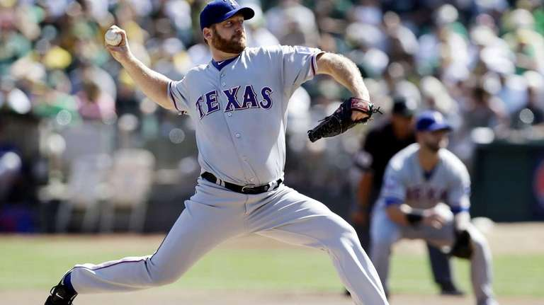 Texas Rangers starting pitcher Ryan Dempster throws a