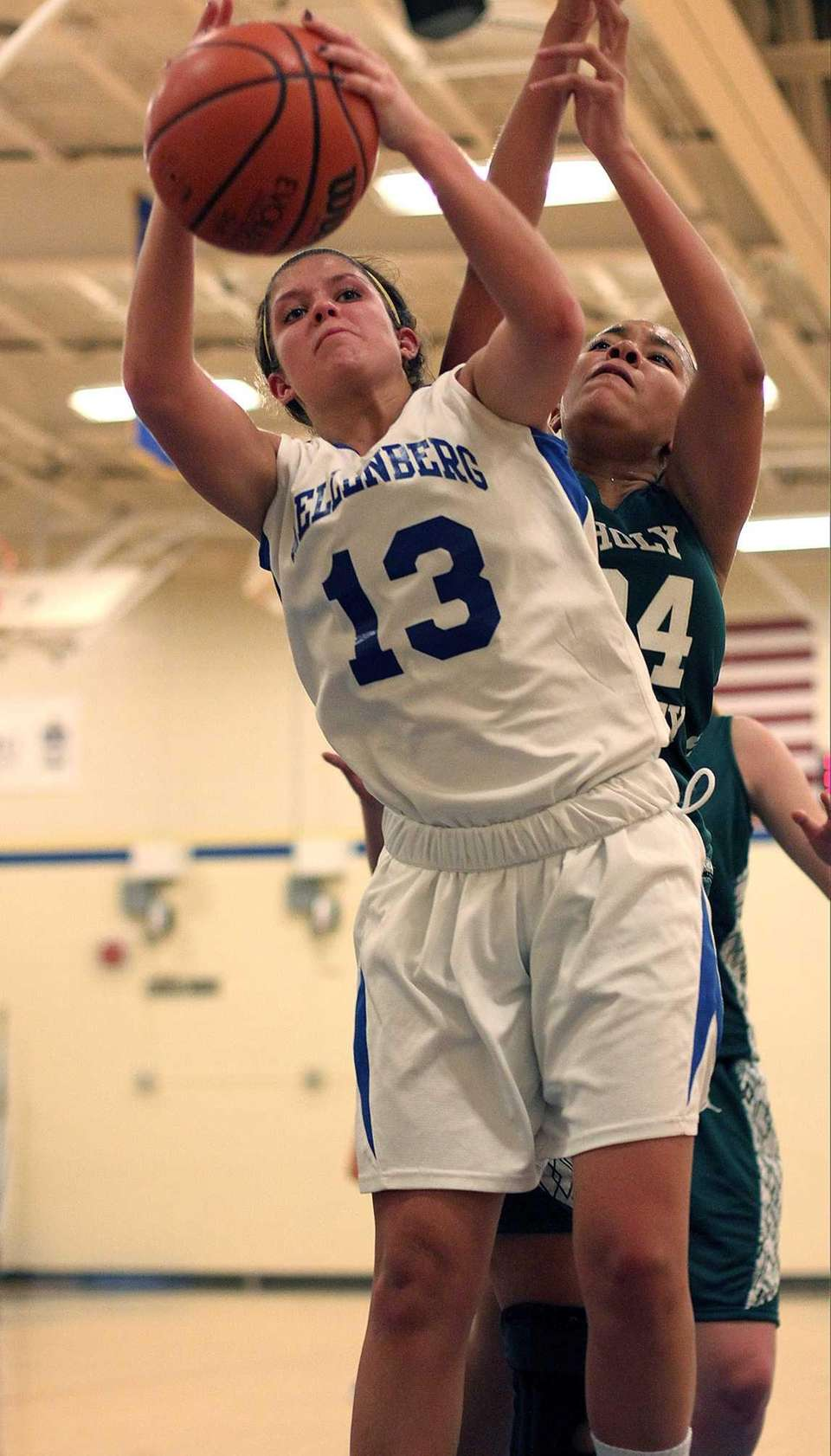 Kellenberg's Kaitlyn Stackpole goes for the rebound in