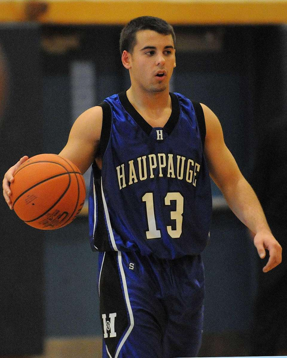 Hauppauge's C.J. Capilets dribbles upcourt in the second