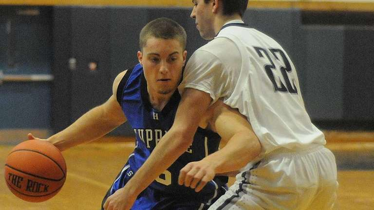 Hauppauge's Cory Wood, left, gets pressured by Huntington's