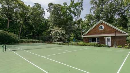 The house has a tennis court and tennis