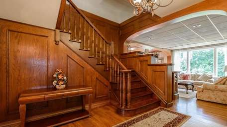 The seven-bedroom home features oak wood floors.