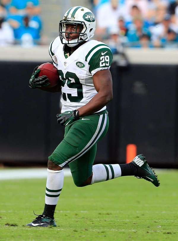 Bilal Powell runs for yardage during a game