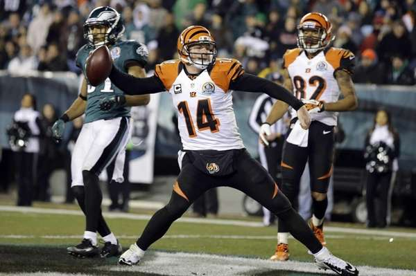 Cincinnati Bengals quarterback Andy Dalton spikes the ball