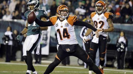 Cincinnati Bengals quarterback Andy Dalton spikes the ball