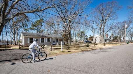 Philip Miller, of Flanders, bicycles down Temple Avenue