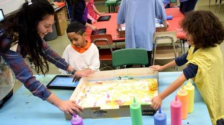 In Holtsville, second-graders in Alexis Curcio's art class