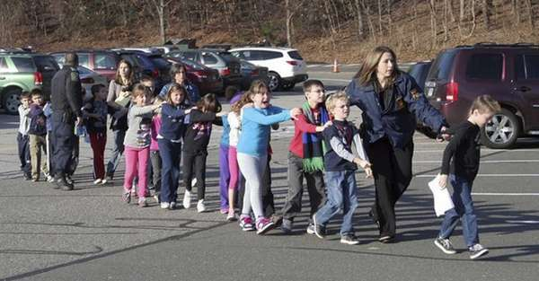Connecticut State Police lead children from Sandy Hook