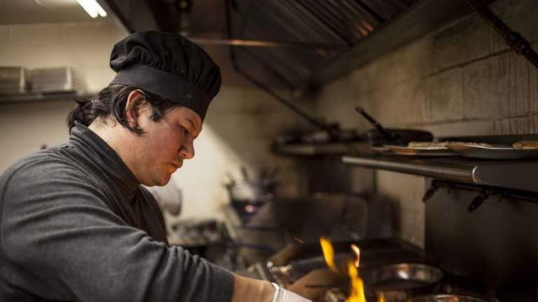 Chef Tito Onofre is busy at work at
