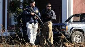Law enforcement officials canvass an area following a