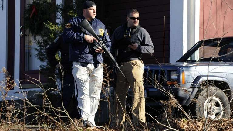 Law enforcement officials canvass an area following a
