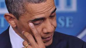 President Barack Obama wipes his eye as he