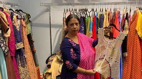 Poonam Jain stands inside her shop, Vastra Boutique
