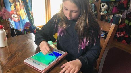 Skylar Kane, 10, of Massapequa, creates invitations on