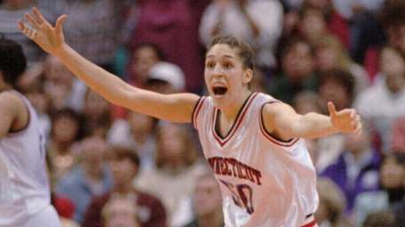 Connecticut's Rebecca Lobo races down the court after