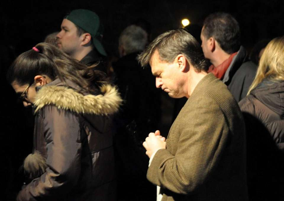 Mourners attend a special Mass at St. Rose