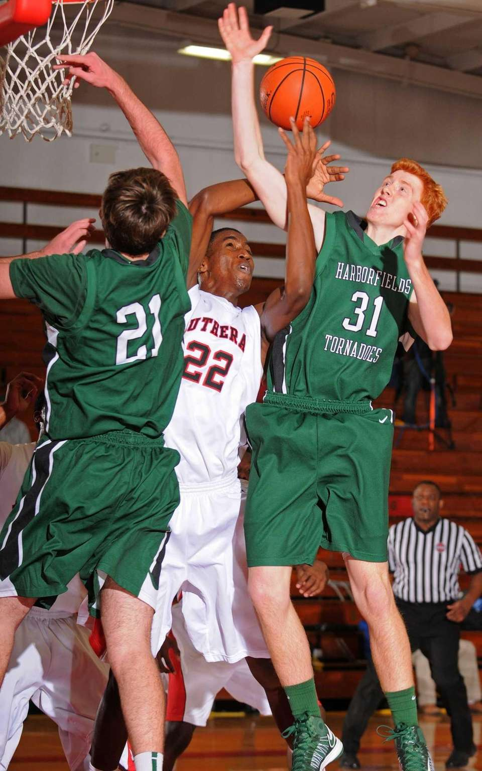 Lutheran's Kentan Facey, center, battles for a rebound