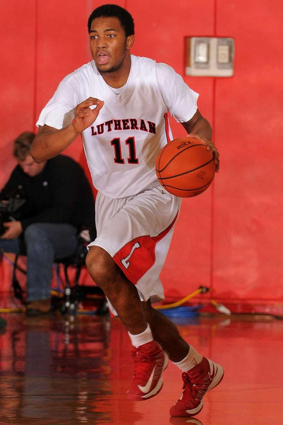 Lutheran's Tawayne Anderson dribbles upcourt in the third