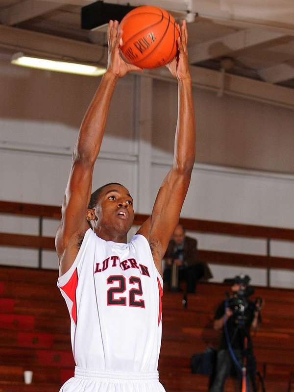 Lutheran's Kentan Facey pulls down a rebound in