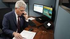 Suffolk County Executive Steve Bellone answers a call