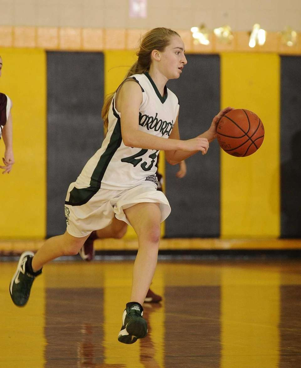 Harborfields' Toni Deren dribbles the ball upcourt during