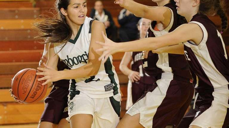 Harborfields' Amy Luxemberg tries to pass the ball