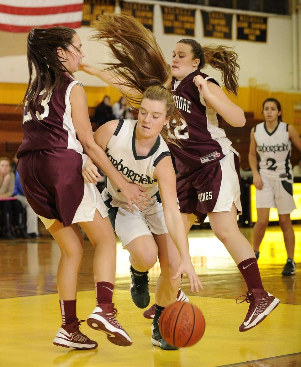 Harborfields' Amy Wertbitsky is fouled by North Shore's