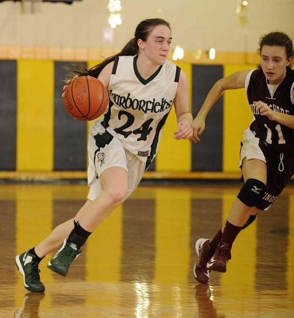 Harborfields' Bridgit Ryan drives the ball as North