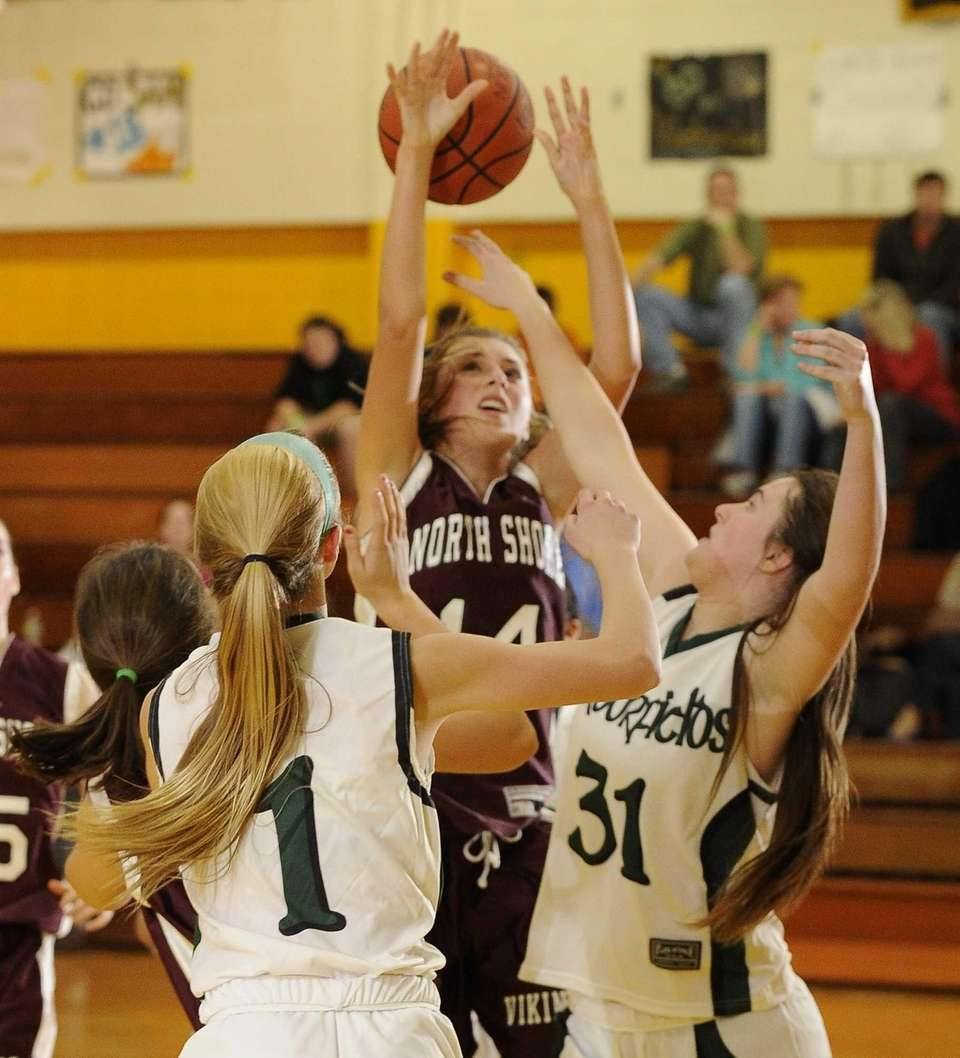 North Shore's Alexandra Cantwell is fouled by Harborfields'