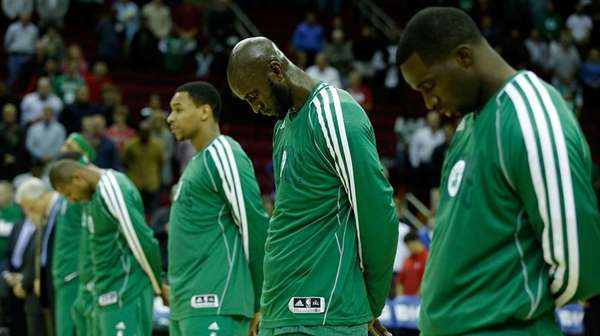Members of the Boston Celtics take a moment