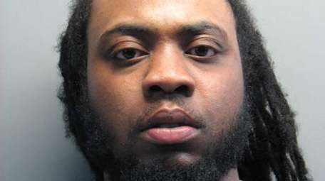 Kaneik Brown, 27, of Valley Stream, faces a