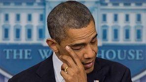 President Barack Obama wipes his eye as he
