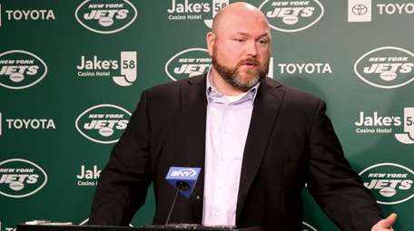 Jets GM Joe Douglas speaks to reporters during