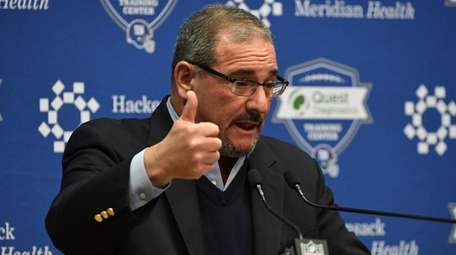 Giants general manager Dave Gettleman speaks to the