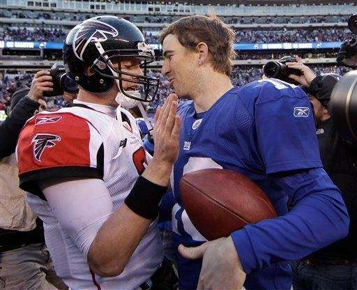 Eli Manning, right, chats with Atlanta Falcons quarterback