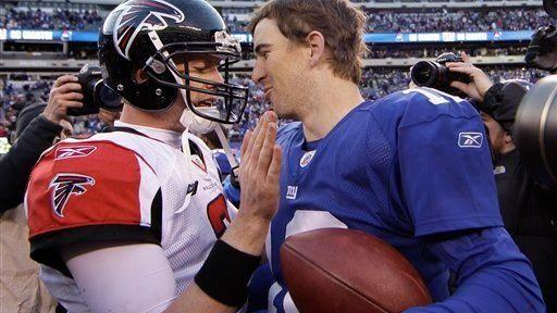 Eli Manning, right, chats with Atlanta Falcons quarterback