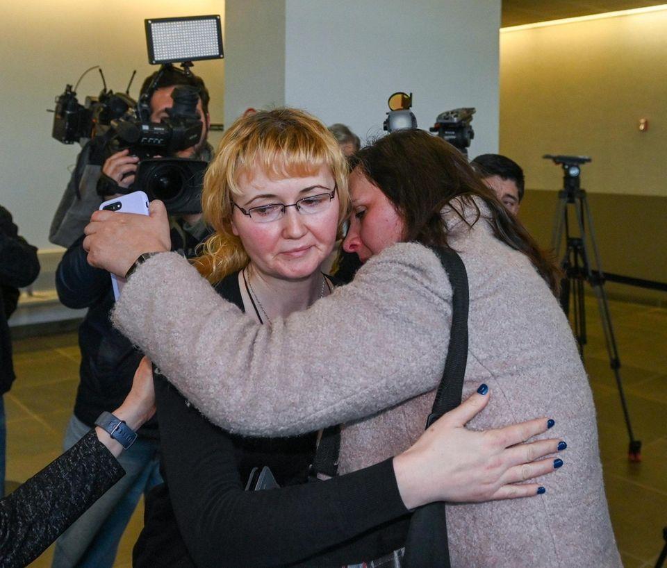Justyna Zubko-Valva, left, is hugged bv a friend