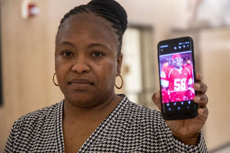 Tihesha Climer, mother of Johmeik Simmons, holds a