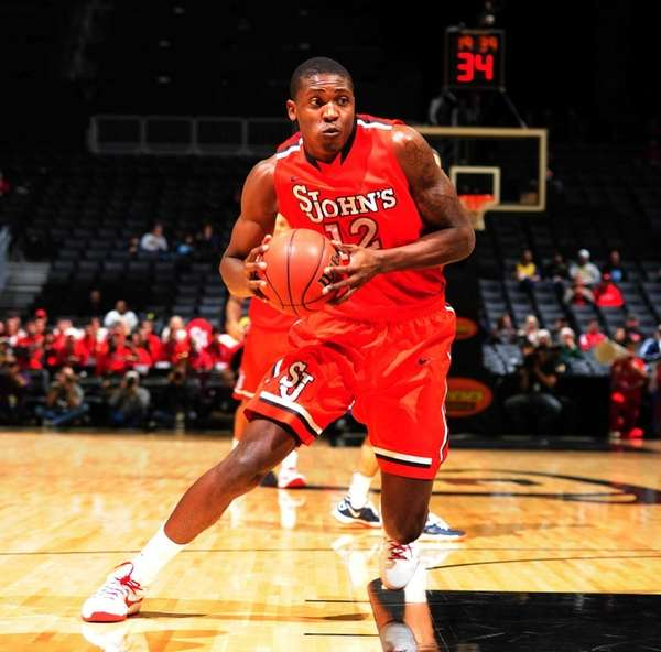 Chris Obekpa of St. John's drives to the