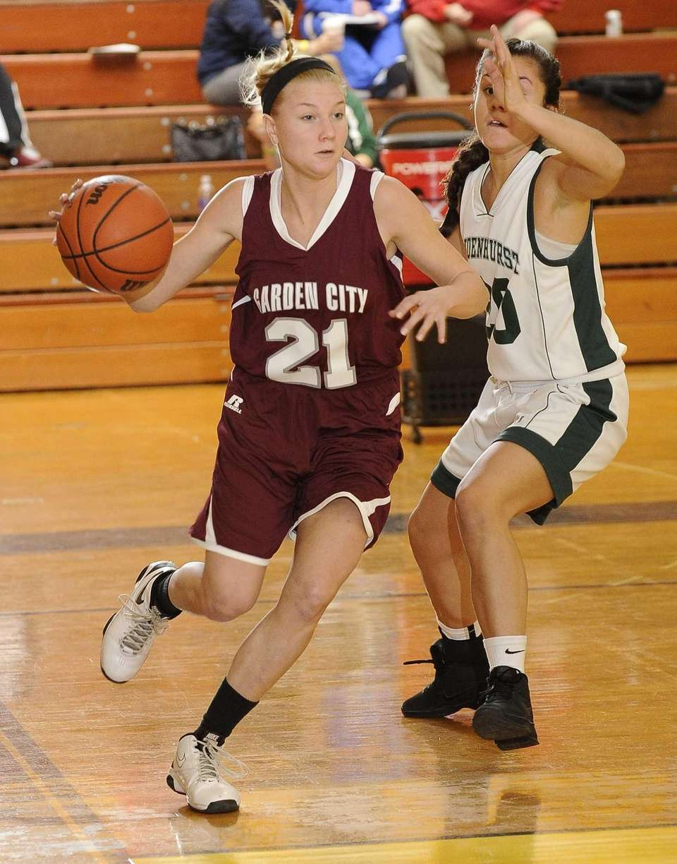Garden City's Tara DeAngelo drives around Lindenhurst's Ariana