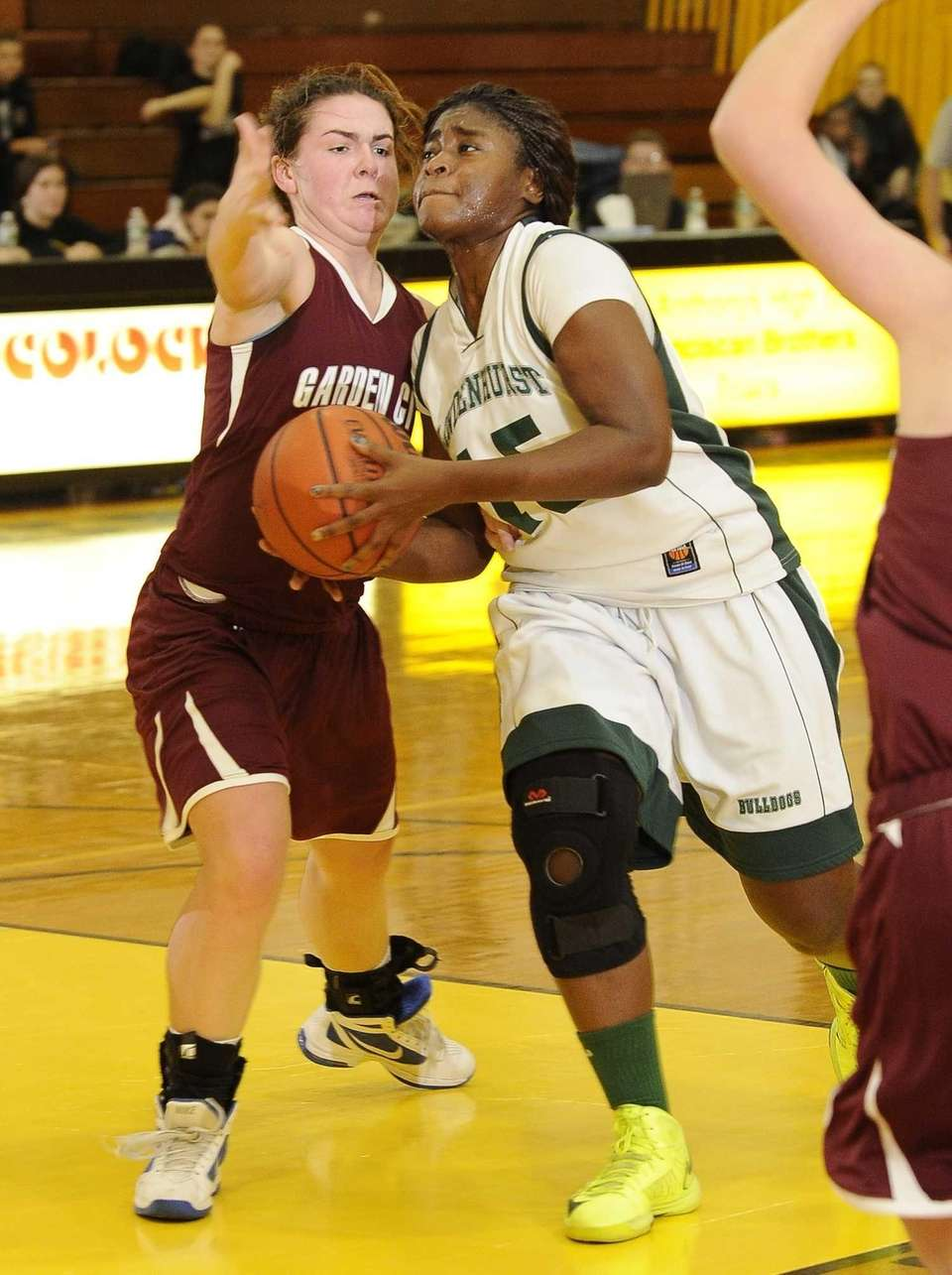 Lindenhurst's Valerie Oyakhilome drives to the basket past