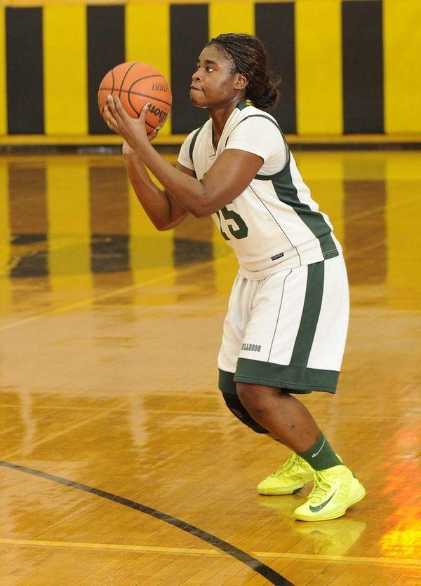 Lindenhurst's Valerie Oyakhilome lines up a 3-point shot